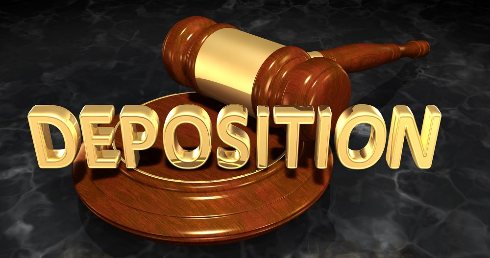 A medium wood color gavel with a gold accent and block with the word DEPOSITION in gold resting on the block, posing the question, Do Personal Injury Cases Settle After Deposition in Philadelphia?