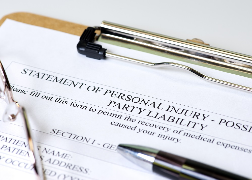 A black pen on top of a clipboard with a form titled STATMENT OF PERSONAL INJURY - PARTY LIABILITY, representing how to file a personal injury lawsuit in Philadelphia.