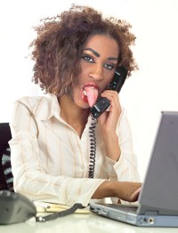 Casual Businesswoman on Telephone --- Image by © Royalty-Free/Corbis