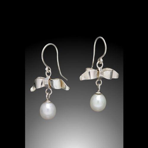 Photo of Bow and Pearl Drop Earrings by Joana Miranda
