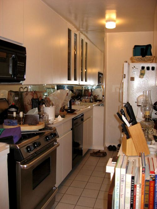 Photo of our chaotic kitchen shortly after we moved by Joana Miranda