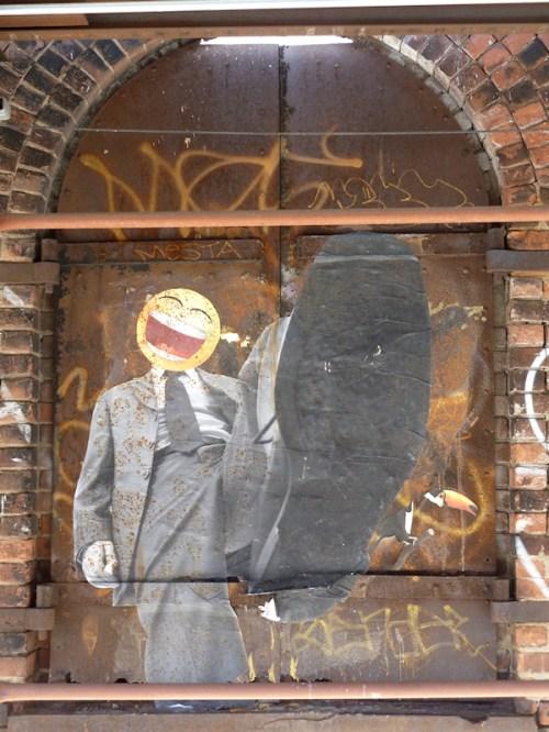"Photo of whimsical ""corporate"" graffiti on Brooklyn wall, taken by Joana Miranda"
