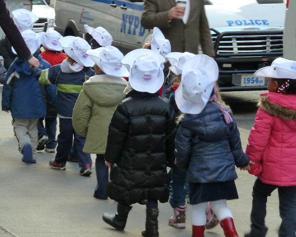Photo of cute children in white hats on a field trip in NYC, taken by Joana Miranda