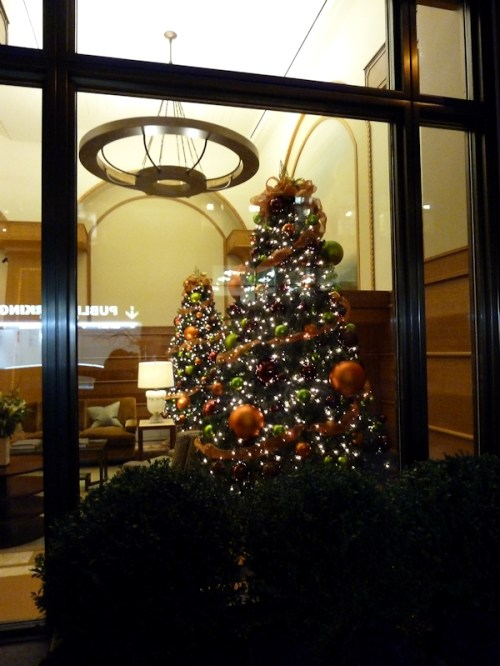 Photo of two Christmas trees in Upper West Side apartment building lobby, taken by Joana Miranda