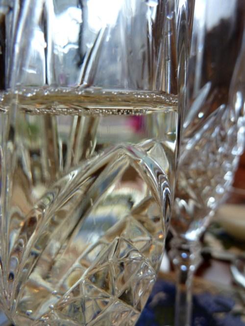 Photo of champagne glasses in the sunlight, taken by Joana Miranda