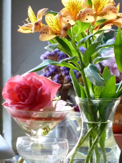 Photo of several glass vases of fresh flowers, taken by Joana Miranda