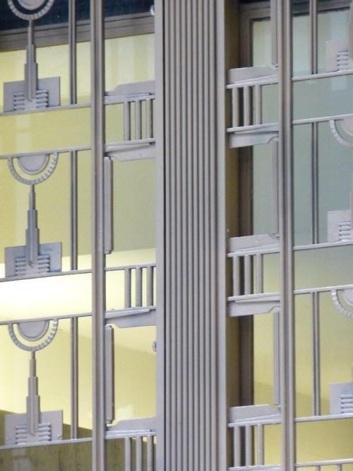 Photo of Art Deco windows on skyscraper in Wall Street area, taken by Joana Miranda