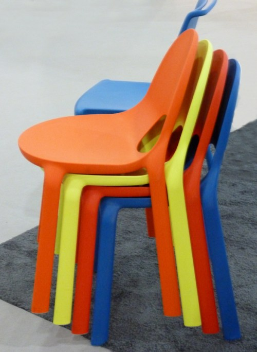 Photo of colorful stacked plastic chairs, taken by Joana Miranda