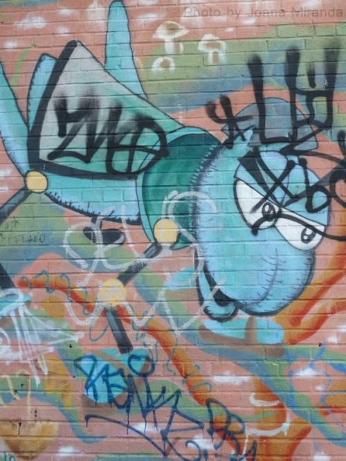 Photo of angry blue insect graffiti, taken by Joana Miranda