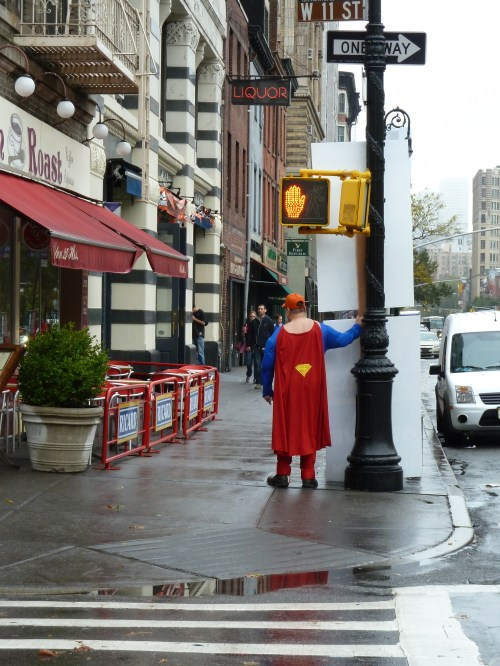Photo of man in a superhero cape on the streets of New York, taken by Joana Miranda
