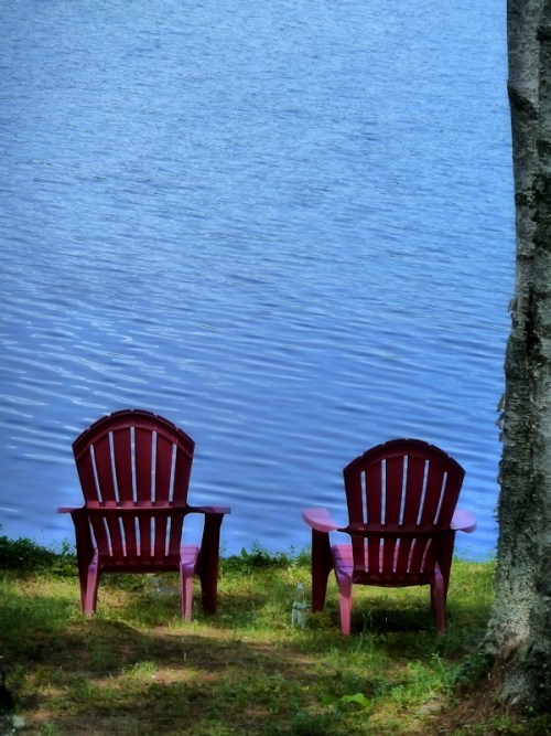 two red chairs on Goose Pond