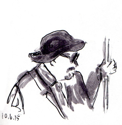Man with hat and dark glasses on the subway