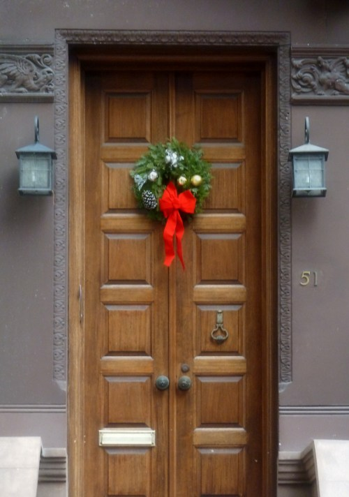 wooden doorway with holiday wreath