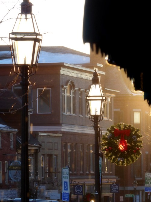 Sunlit lamps and wreath in Portsmouth, NH