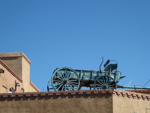 blue carriage on rooftop in Santa Fe