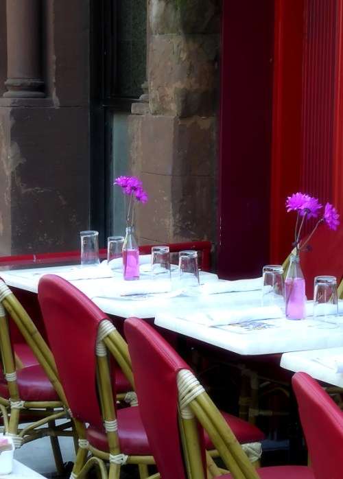 Outdoor cafe with pink flowers