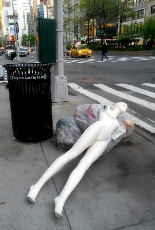 Photo of nude mannequin on a trash pile in Manhattan, taken by Joana Miranda