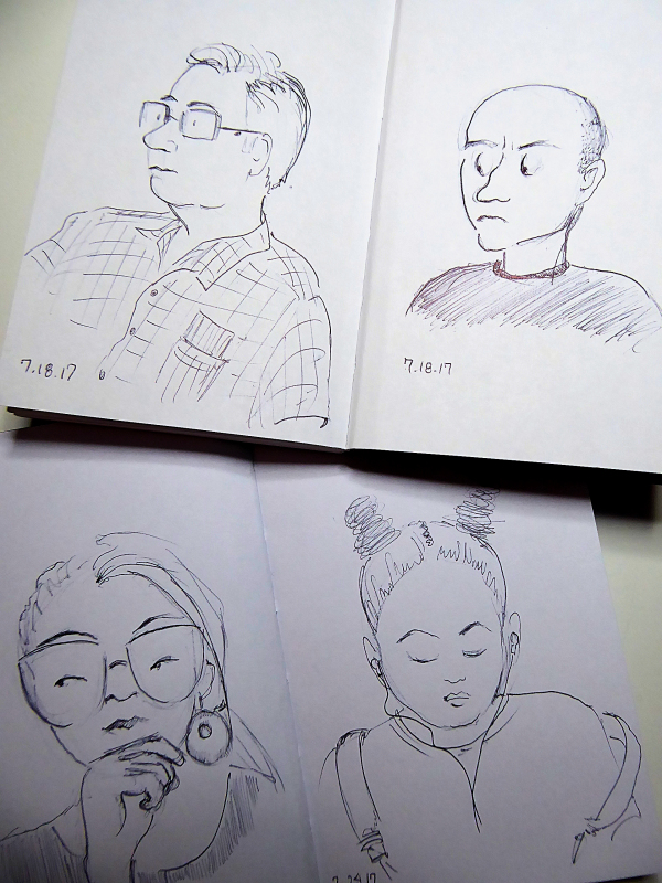 Photo of four pages from two of my sketchbooks, taken by Joana Miranda