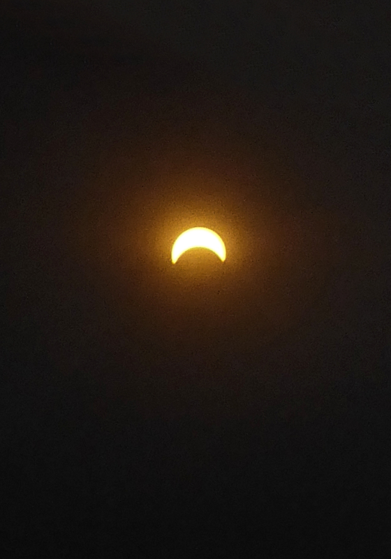 Photo of eclipse as seen from Mt. Cardigan, NH, taken by Joana Miranda