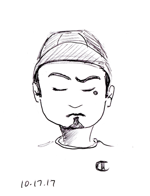 Quick pen sketch of man with goatee and baseball cap, by Joana Miranda