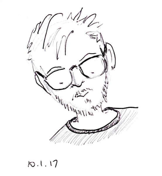 Quick ballpoint pen sketch of man with glasses and spikey hair by Joana Miranda