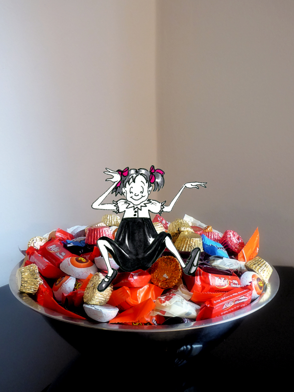 Funny photo of bowl of candy with cartoon girl sitting atop, photo and cartoon by Joana Miranda