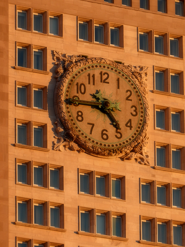 Large clock on building facade on the lower East Side, photo by Joana Miranda