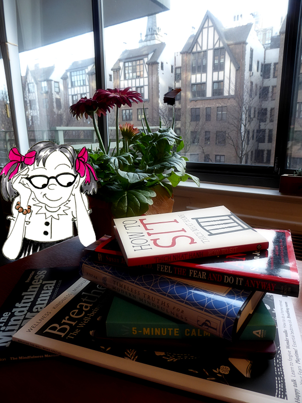Funny cartoon photo of Jo wearing glasses with her stack of mindfulness books, by Joana Miranda