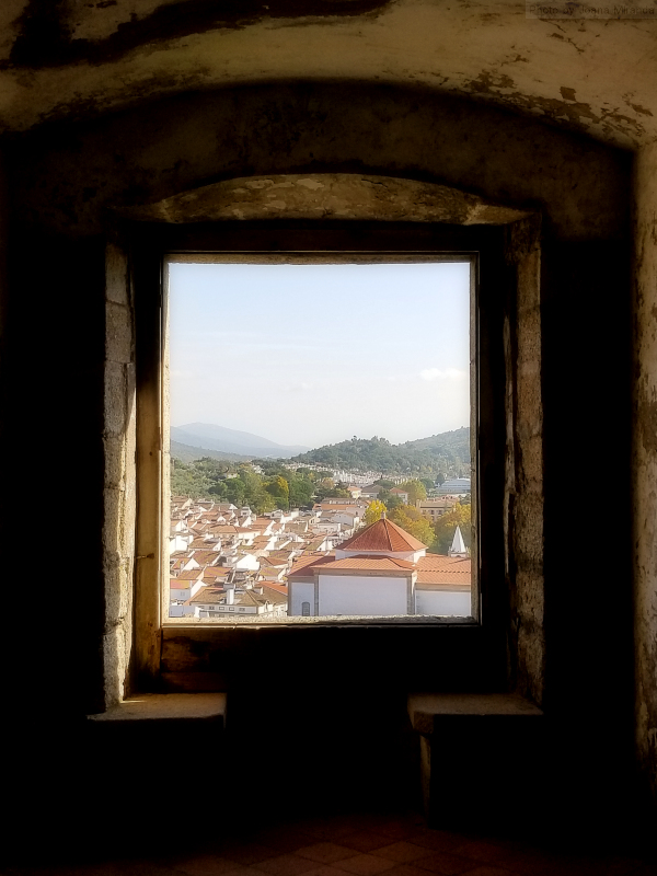 View through castle window over Castelo de Vide