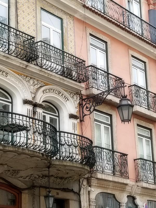 Pretty iron grill-work balconies in Lisbon, Portugal