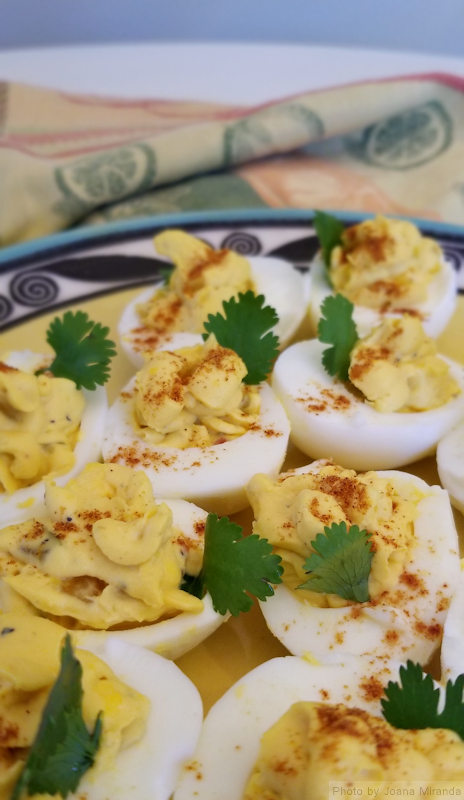 Photo of homemade deviled eggs on a yellow plate, taken by Joana Miranda