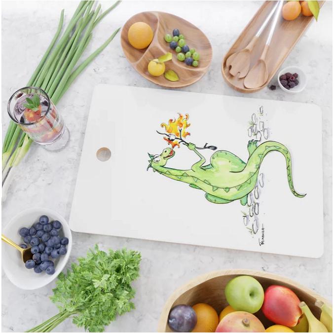 Funny Dino Art cutting board by Joana Miranda Studio at Society6
