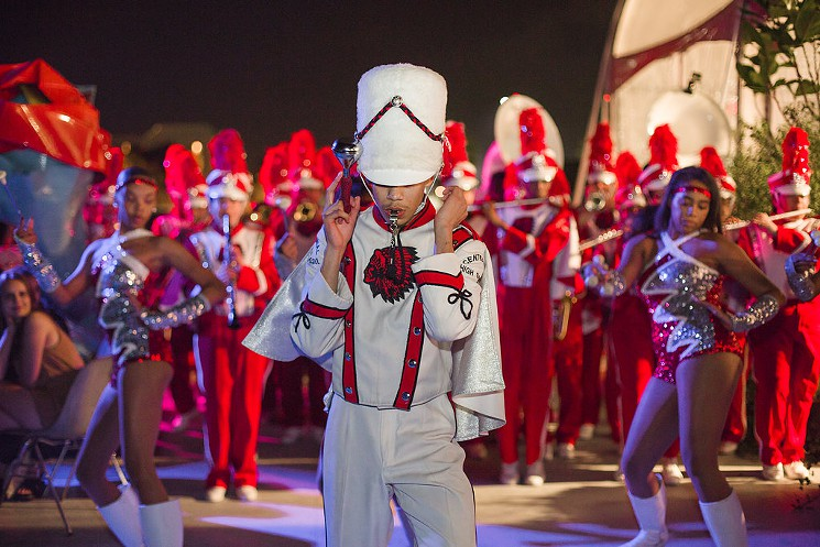 Geovanny, the drum major, leading the band. PC: Gina Clyne/Art Los Angeles Contemporary