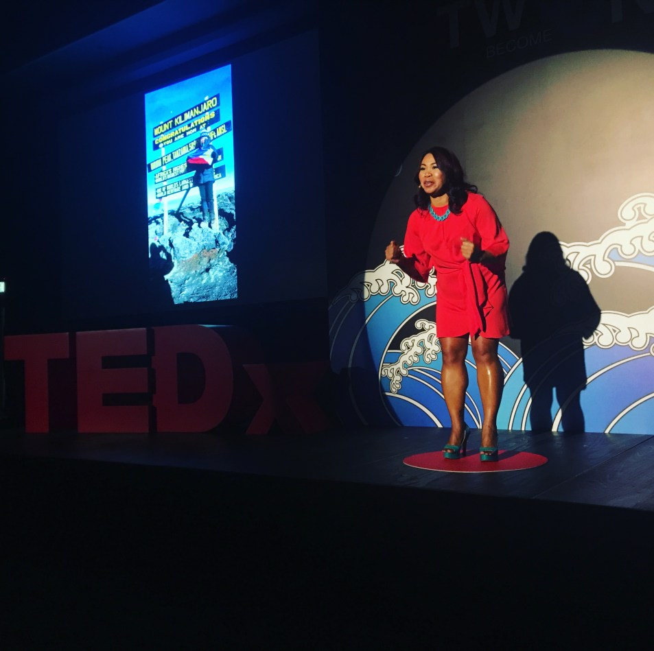 Liza Avelino on stage at Tedx TinHau Women
