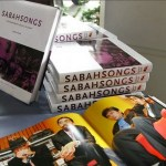 a pile of the SabahSongs: Contemporary Music in Sabah book, written by Joanna Funk, on a table