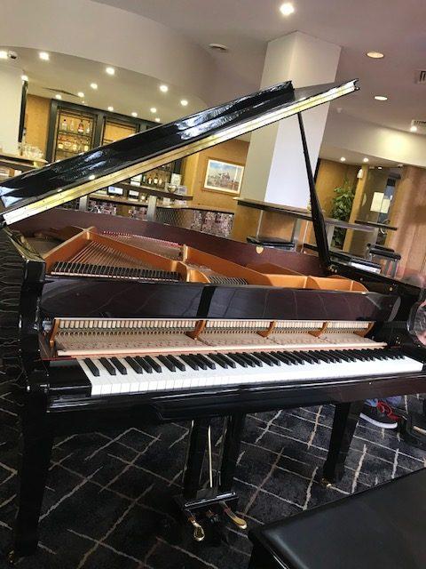 Gerard tunes the resort piano