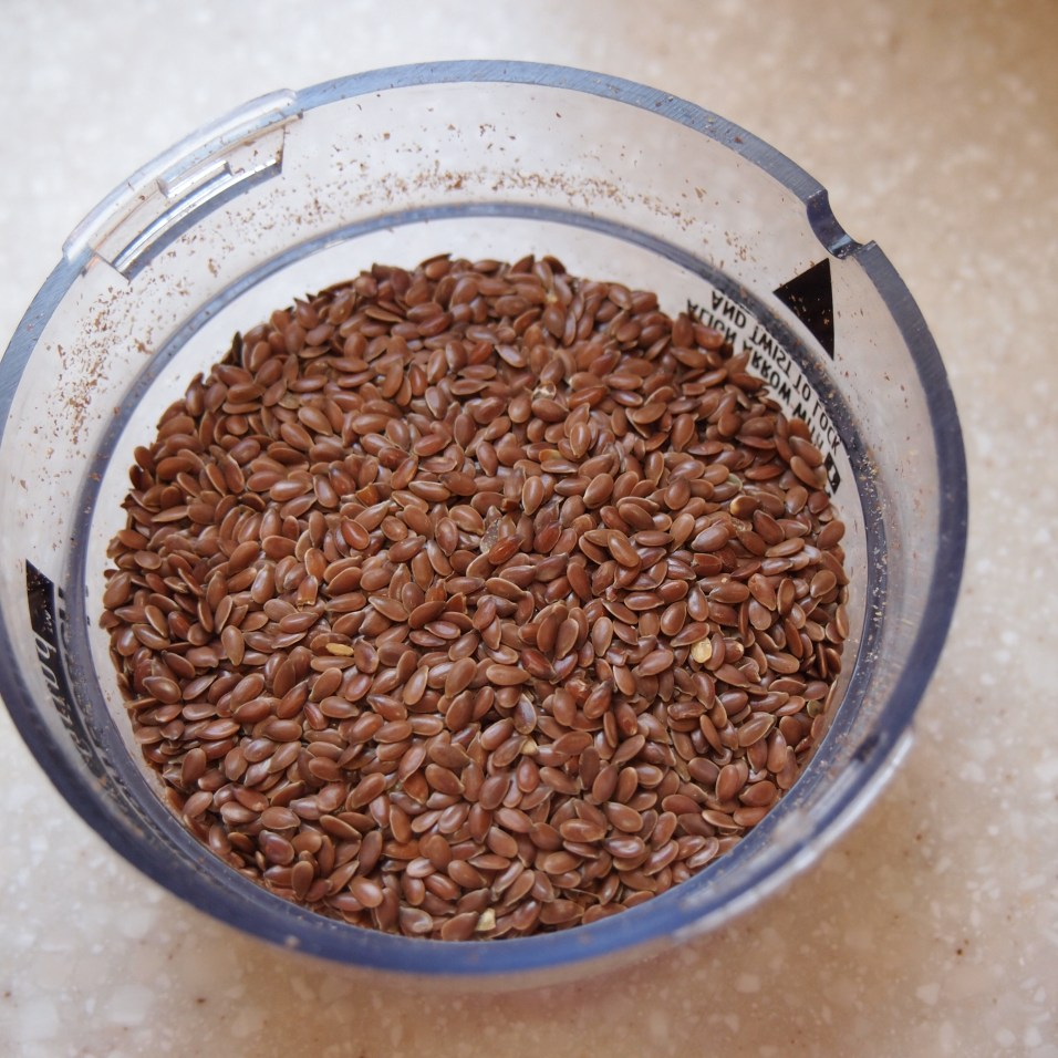 Pour the flax seed into the lid - Copyright Jo-Ann Blonding