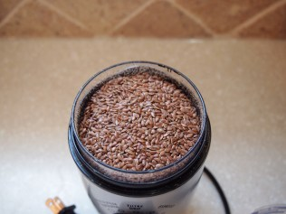 Pour the lid contents into the grinder - Copyright Jo-Ann Blondin