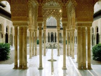 the-courtyard-of-the-lions-at-the-palace-of-the-lions-in-the-alhambra-granada-spain