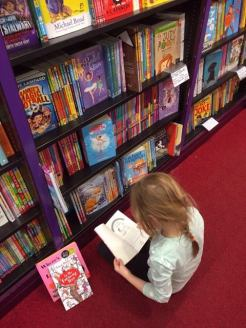 Charlotte choosing books April 2017c