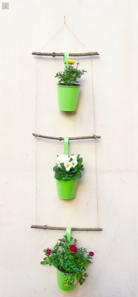 diy hanging flower decor - 3 sticks hanging on ropes with 3 green flower pots