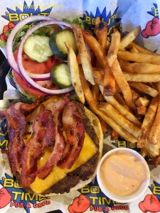 Bacon Cheeseburger with fries from Bout Time Pub and Grub