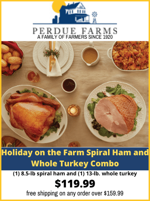 Table with ham and turkey from Perdue Family Farms