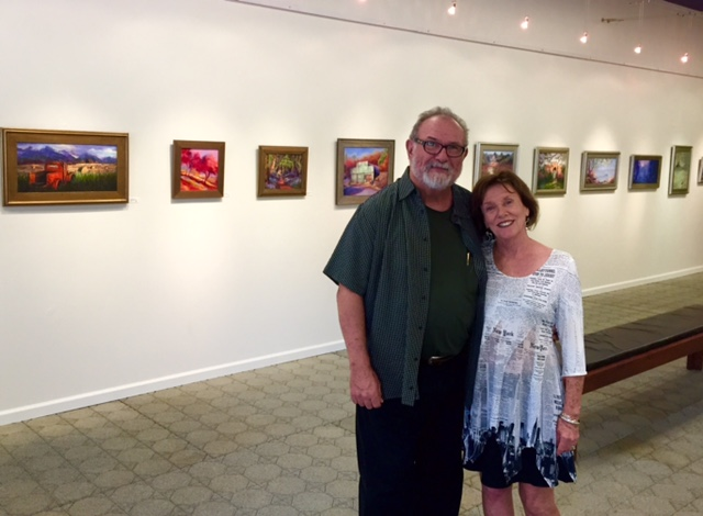 Author (and husband) Charlie Price with Joan Pechanec with paintings at her September 2015 solo art show at the Orland Art Center in California