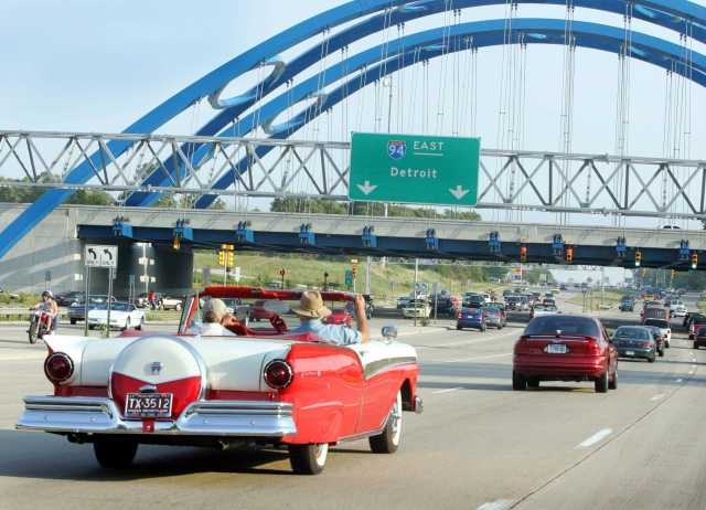 With top down and the sun shining, cruisers headed to Telegraph Road last year for the Telegraph Tomorrow Car Cruise. Organizers are hoping for beautiful weather Saturday for this year's cruise and are expecting thousands of hot rods, classic cars and sports cars up and down Telegraph Road, from Taylor to Redford Township. (Larry Caruso/Photo Editor)