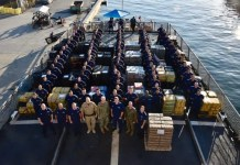 The Coast Guard Cutter Forward (WMEC-911) crew stand amongst 34,780 pounds of interdicted cocaine aboard at Port Everglades, Florida, Feb. 5, 2019. U.S. Coast Guard Photo