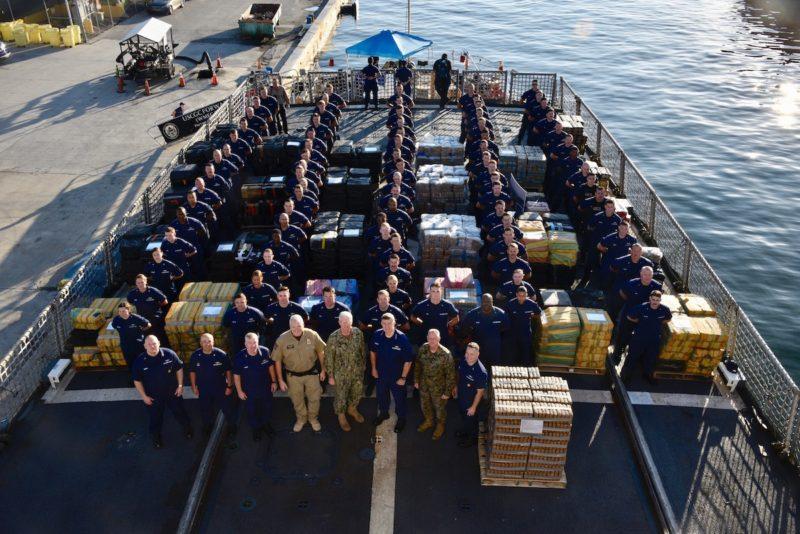 The Coast Guard Cutter Forward (WMEC-911) crew stand amongst 34,780 pounds of interdicted cocaine aboard at Port Everglades, Florida, Feb. 5, 2019. U.S. Coast Guard Photo