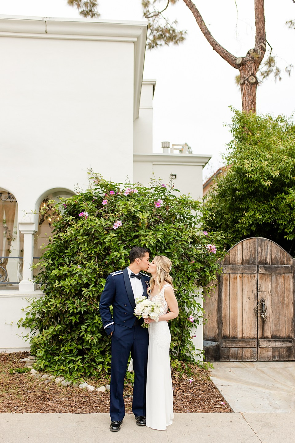 Angela & Kevan sharing a kiss outside their Villa & Vine Wedding venue.