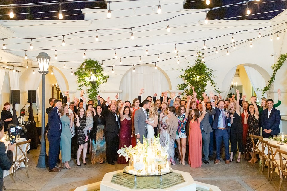 A second photo of the entire wedding party cheering at the couple's kiss during their Villa & Vine Wedding