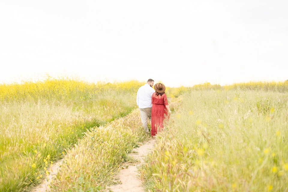 Brian leading Maddy down a path away from the camera during their Ellwood Bluffs engagement session